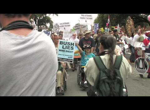 Hand-held-shot of anti-Iraq-war protestors carrying signs... Stock Video Footage
