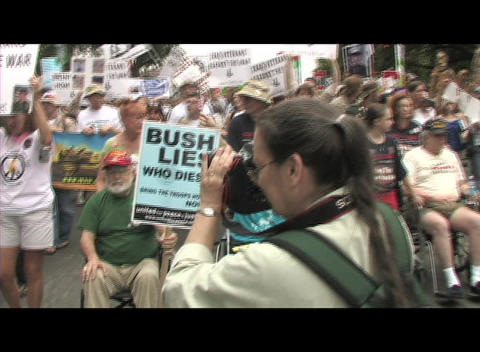 Hand-held-shot of anti-Iraq-war protestors carrying signs during a demonstration march Footage