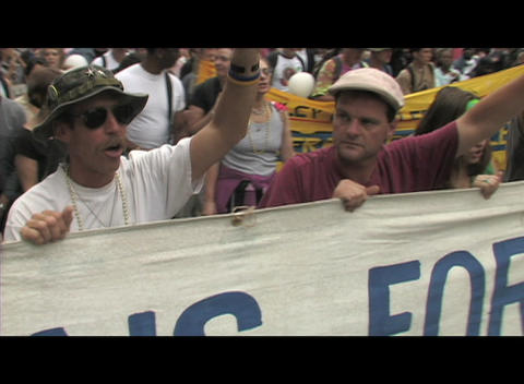 Pan-left shot of anti-Iraq-war protestors marching in... Stock Video Footage