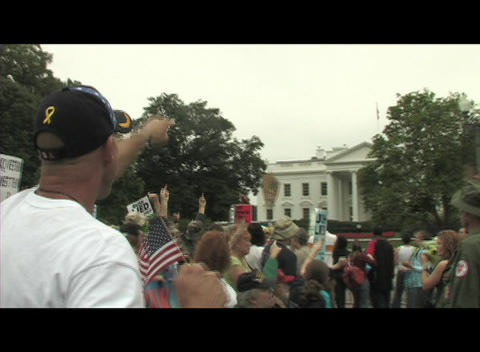 Hand-held-shot of anti-Iraq war protestors demonstrating in front of the White House Footage