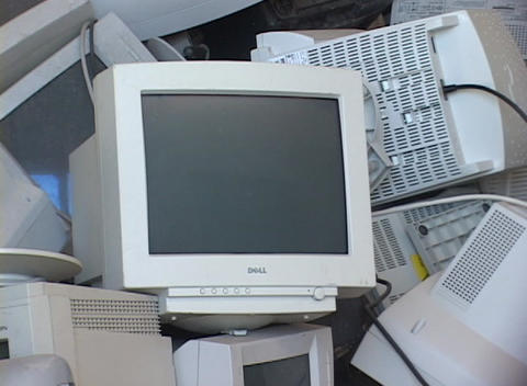 Stacks of discarded computer screens and monitors fill a... Stock Video Footage