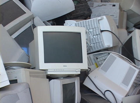 Stacks of discarded computer screens and monitors fill a storage area Footage