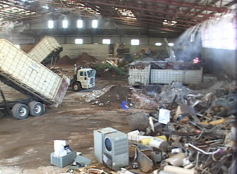 Workers unload scrap metal in a large recycling center Footage
