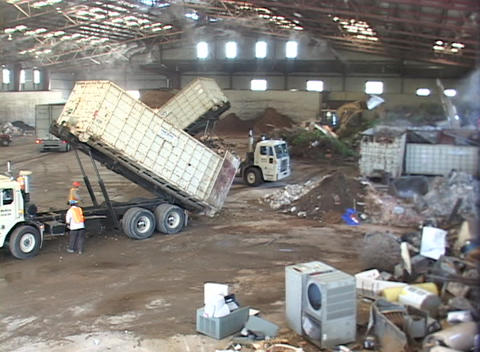 Workers unload scrap metal in a large recycling center Stock Video Footage