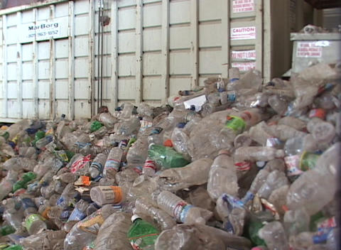 Workers prepare large piles of discarded plastic bottles... Stock Video Footage