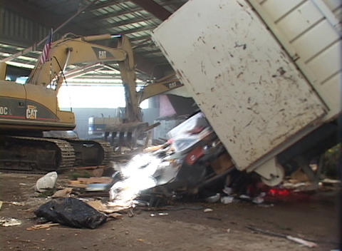large diesel shovels pile material in a recycling center Stock Video Footage