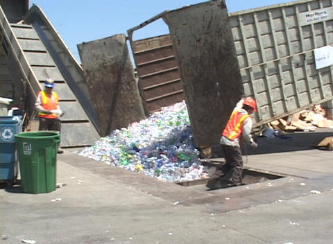Workers unload thousands of plastic bottles at a... Stock Video Footage