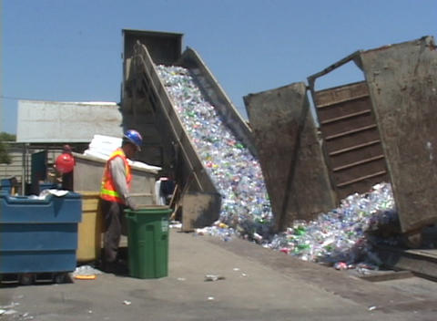 A conveyor belt moves thousands of plastic bottles at a recycling center Footage