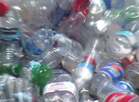 Thousands of plastic bottles are unloaded in a recycling... Stock Video Footage
