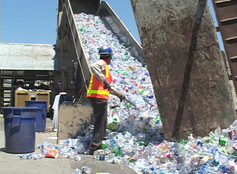 Thousands of plastic bottles are unloaded in a recycling center Footage
