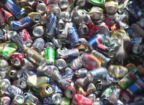 Aluminum cans move down a conveyor belt in a recycling center Footage