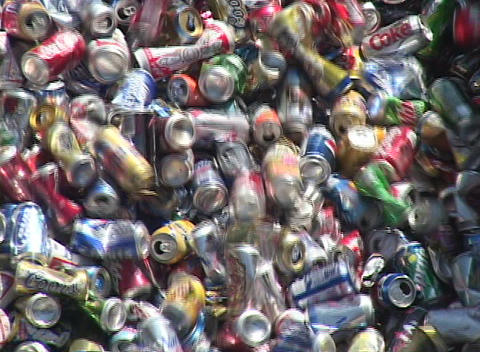 Aluminum cans move down a conveyor belt in a recycling... Stock Video Footage