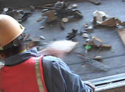 Workers sort garbage from a conveyor belt at a recycling plant Footage