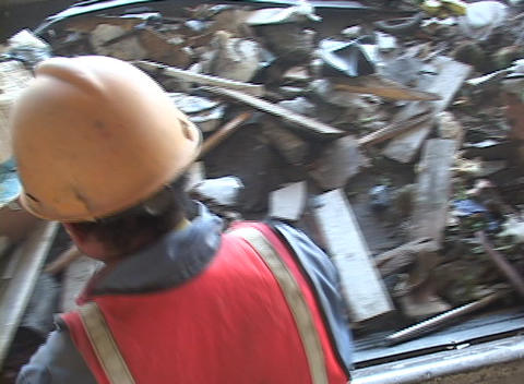 Workers sort garbage from a conveyor belt at a recycling... Stock Video Footage