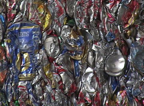 Blocks of aluminum cans are stacked at a recycling center Stock Video Footage