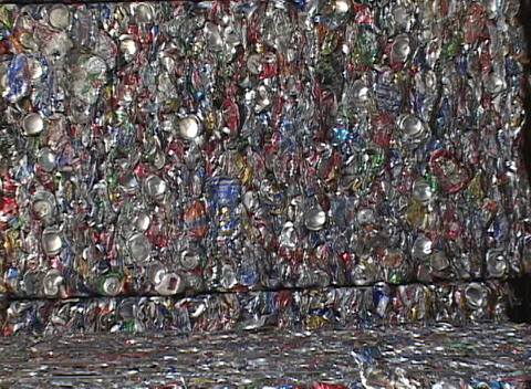 Blocks of aluminum cans are stacked at a recycling center Footage