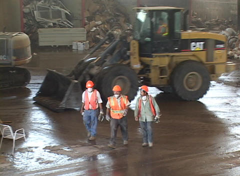 Workers exit a recycling center Stock Video Footage
