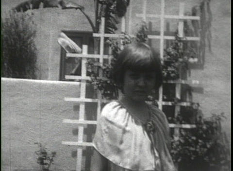 Home movie shots of a family in front of a house includes... Stock Video Footage
