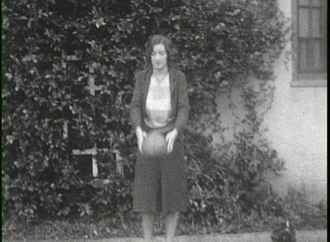 Kids play in the yard and a woman kicks a football ion... Stock Video Footage