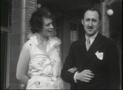 Newlywed couple standing on a porch in 1920's Stock Video Footage