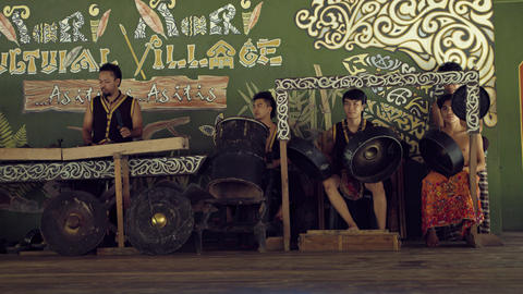 Local musicians play traditional instruments at an cultural village Footage