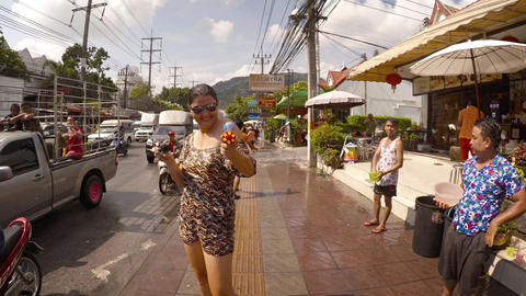 Direct hit from water gun at Songkran water festival in Patong. Thailand Footage