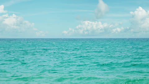 Peaceful Tropical Seascape under a Partly Cloudy Sky. Video UltraHD Footage