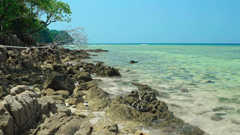 Warm Sea Water Washes over a Rocky Tropical Beach Footage