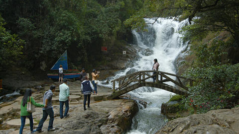 Group of visitors crossing foot bridge at the base of Datanla Falls near Da Lat Footage
