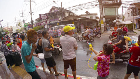 People splashing each other at Songkran Thai New Year celebration in. Thailand Footage