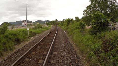 Walking alongside a railroad track near Nha Trang Footage