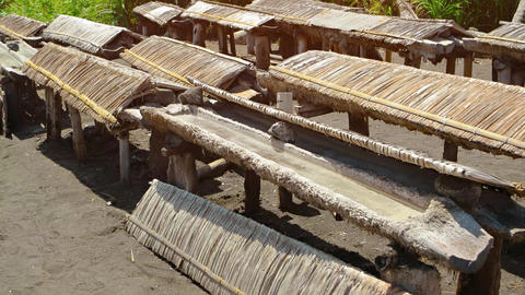 Troughs of Brine Drying in the Sun to Produce Edible Salt Footage
