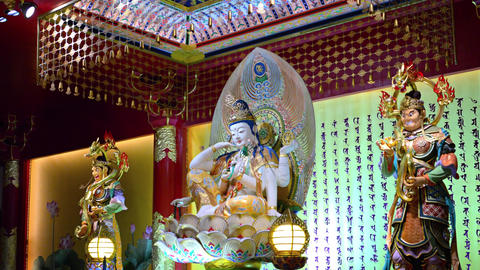 Intricate sculptures of deities inside the buddha tooth Relic temple Footage