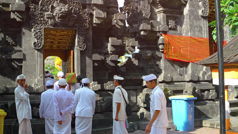Local men in traditional dress. entering Pura Goa Lawah temple Footage