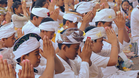 Group of Hindu children praying at Pura Goa Lawah temple Footage