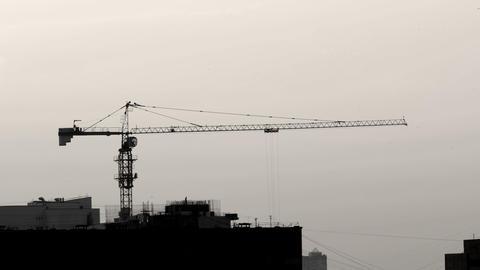Enormous Construction Crane Lifting Concrete Bucket in Timelapse Footage