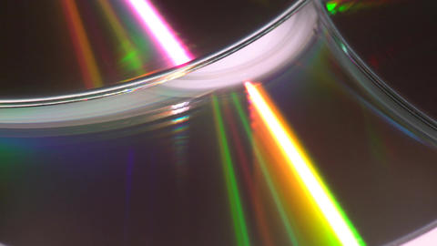 Shiny colorful reflection on CDs Footage