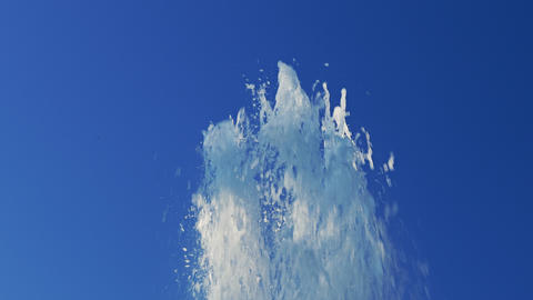 4K Splashes of Water Fountain Against Blue Sky Footage