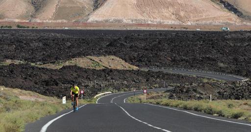 Male cyclist biking on road race cycling on racing bike Live Action