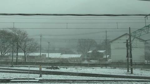 Japan railway window. Car window during snowfall Live Action