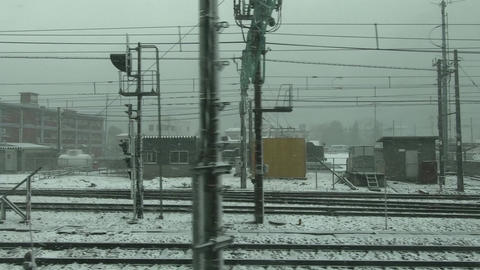Japan railway window. Arrive at the station during snowfall Live Action
