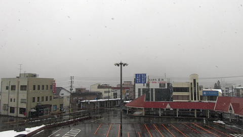 Rotary in front of the station where snow covered with clouds was falling GIF