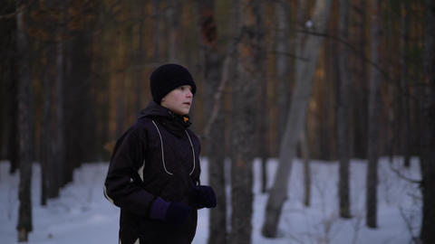 Young Male Athlete Jogging In Wintry Wood Live Action