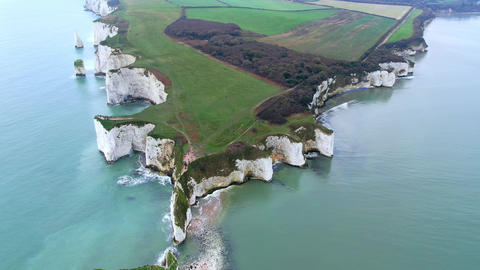 Spectacular aerial view over Old Harry Rocks in England Live Action