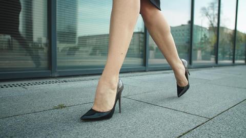 Closeup woman feet walking at street. Woman legs walking in high heel shoes Live Action