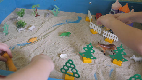 Children's sand therapy. Children's games with sand. Educational activities in Live Action