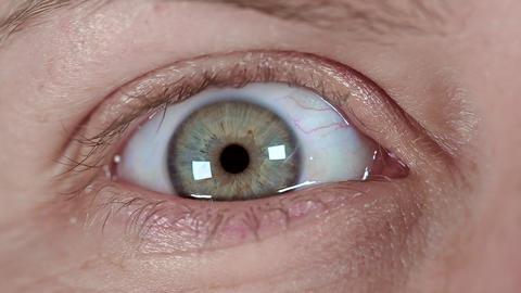 close up macro blue eye closing, human iris natural beauty Live Action