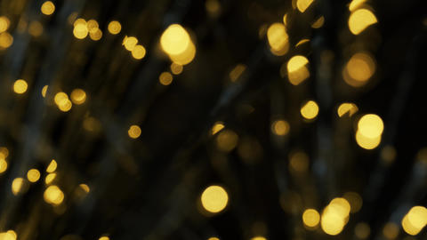 Yellow bokeh lights shimmering. Shiny Christmas blurred lights. Abstract Live Action