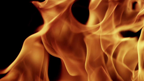 Animation of the movement of a flame fire isolated on a black background HD Live Action