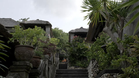 Stone staircase in a tropical cottage village. Slow motion Live Action